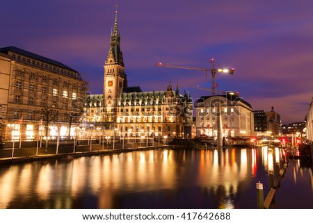 Town hall of Hamburg in Germany during twilight, reflection of light on water in canal