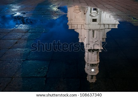 Town hall of Kaunas, Lithuania reflecting in water with blue night sky. Europe. - stock photo