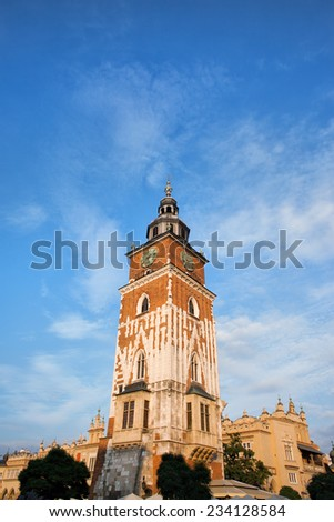 Town Hall Tower in Krakow, Poland. Built of stone and brick in 13th century. - stock photo