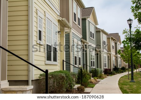 Town houses/ Town Houses/ Town housed in the subdivision of Mueller in Austin, Texas. - stock photo
