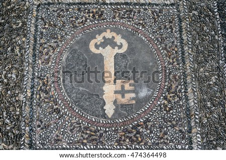 Town key mosaic from pebble stones on the floor of Palazzo Medici Riccardi in Florence, Italy
