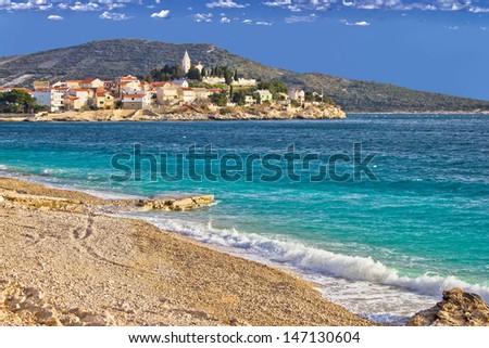 Town of Primosten turquoise sea and pebble beach, Dalmatia, Croatia - stock photo