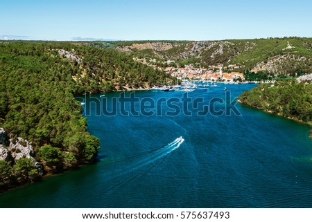 Town of Skradin on Krka river in Dalmatia, Croatia viewed from distance. Skradin is a small historic town and harbour.