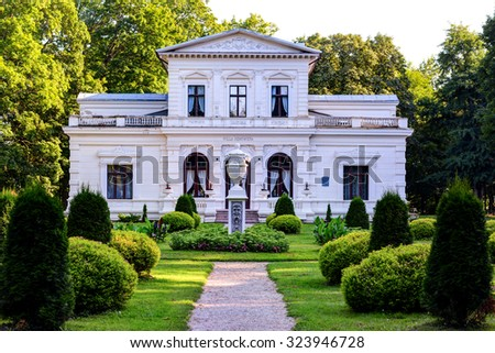 "TOWN OF SVEKSNA, LITHUANIA - 11 AUGUST 2015: Villa ""Genowefa"". Central park of Sveksna town. Lithuania."