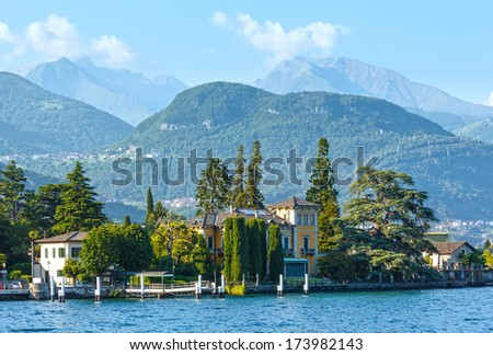 Town on Lake Como coast (Italy). Summer  view from ship board
