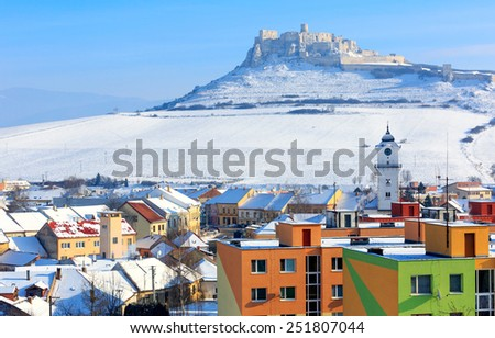 town's roof on old castle background in Slovakia - stock photo