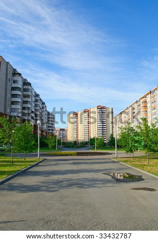 town urban landscape - buildings, street, alley, trees - stock photo