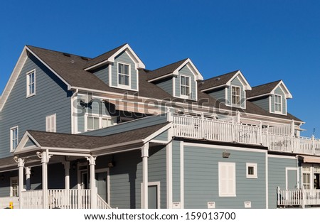 Townhomes with balconies and dormer windows