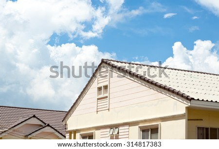townhouses building with blue sky soft focus