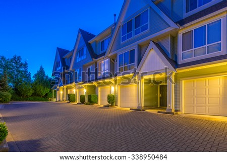 Townhouses, homes, community at  dusk, night time in suburbs of Vancouver, Canada. - stock photo