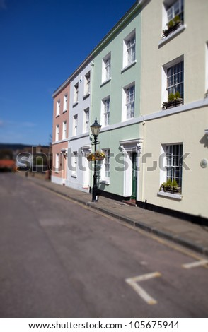 Townhouses in England, row of colorful buildings in town of Folkestone. English homes and street