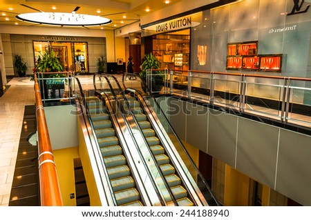 TOWSON, MARYLAND - JUNE 1: Escalators and the Louis Vuitton Store on June 1, 2013 at Towson Town Center, Maryland. Louis Vuitton is a French luxury fashion brand. - stock photo