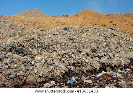 Toxic household trash and hazardous industrial waste contaminates soil and groundwater at the largest and most polluted landfill site on the holiday resort island of Bali, Indonesia. - stock photo