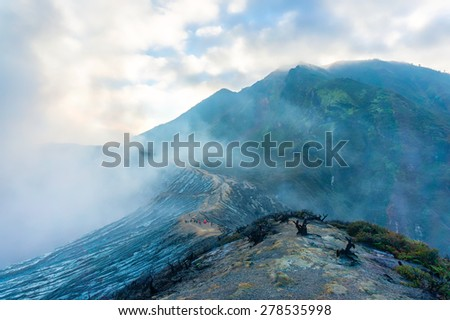 toxic smoke at kawah ijen volcano landscape, java indonesia - stock photo