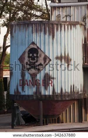 Toxic waste symbol on a blue barrel - stock photo