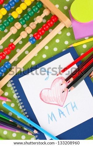 Toy abacus, notebook, pencils on bright background - stock photo