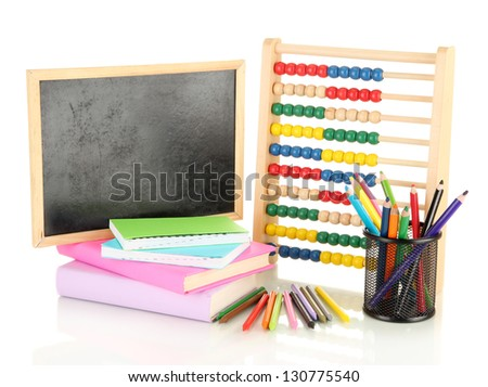 Toy abacus, school desk, books and pencils, isolated on white - stock photo
