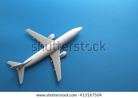 Toy airplane on blue background. - stock photo