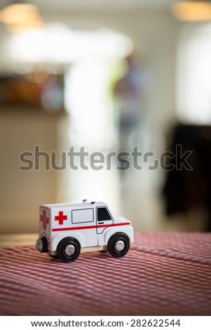 toy ambulance close up with blurred background. Tabletop in a restaurant.  - stock photo