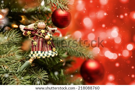 Toy angel hanging on the Christmas tree  - stock photo