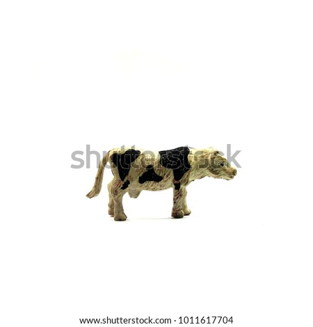 toy animal cow isolated on a white background