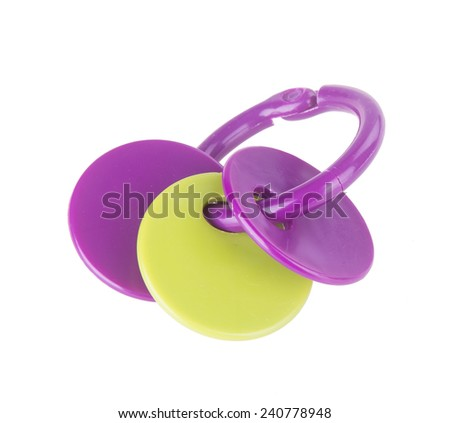 """Toy. baby toy """"key"""" on the background. baby toy """"key"""" on the background. - stock photo"""