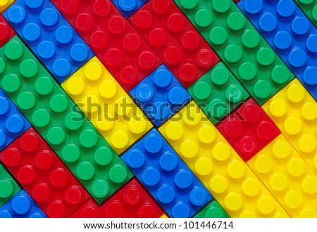 toy background made with color plastic bricks - stock photo