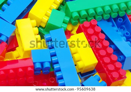 toy background made with color plastic bricks