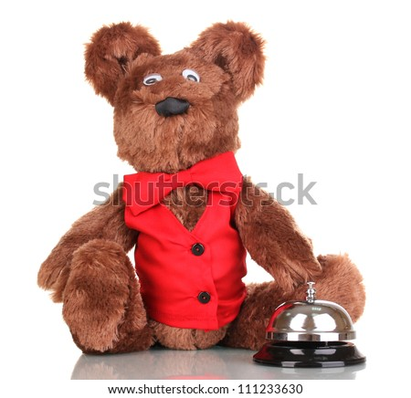 Toy bear and bell isolated on white - stock photo