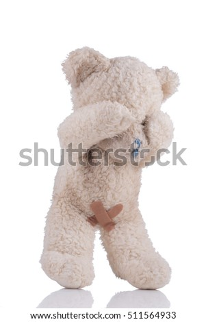 Toy bear with adhesive bandages on his private parts 3/4 view