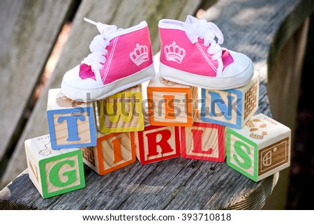 toy blocks and pink shoes for baby girls - stock photo