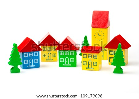 Toy blocks: houses, trees and a church representing a town - stock photo
