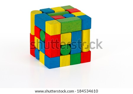 toy blocks jigsaw cube, multicolor puzzle pieces over white background  - stock photo