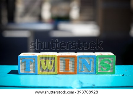 toy blocks spelling out twin babies - stock photo