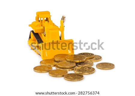 Toy bulldozer and money coins isolated on white background - stock photo