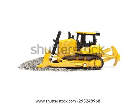 toy bulldozer isolated on white background - stock photo