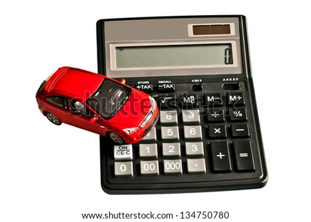 Toy car and calculator. Concept for buying, renting, insurance, fuel, service and repair cost - stock photo