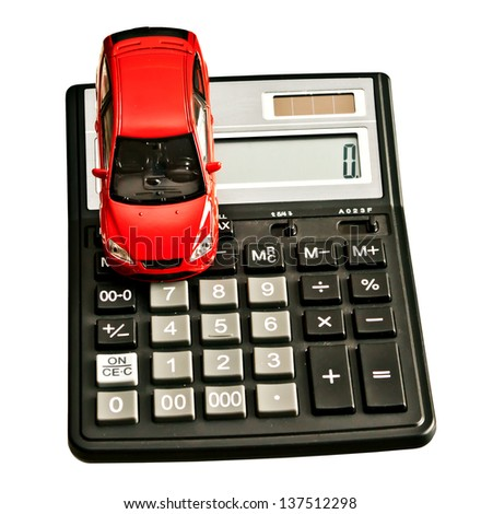 Toy car and calculator. Concept for buying, renting, insurance, fuel, service and repair costs  - stock photo