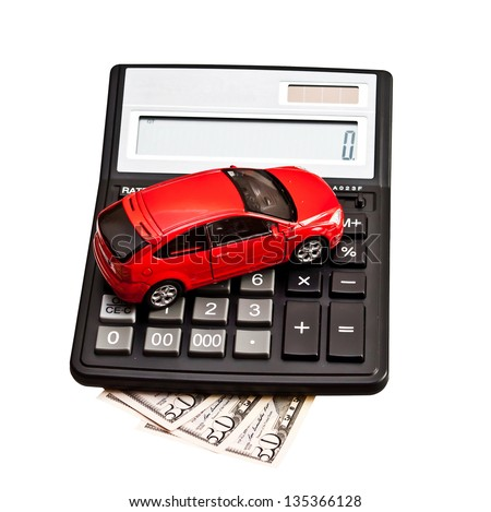 Toy car and calculator over white. Concept for buying, renting, insurance, fuel, service and repair costs - stock photo