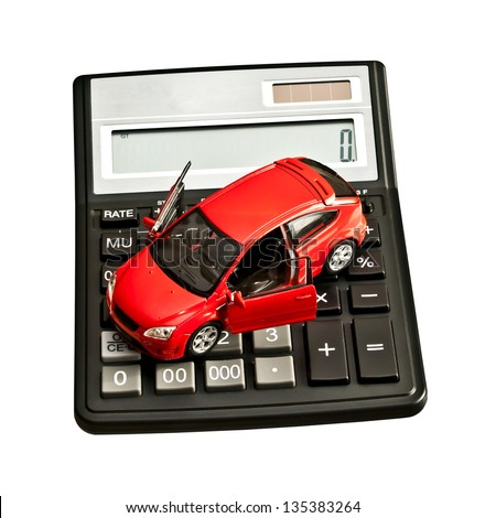 Toy car and calculator over white. Rent, buy, repair or insurance car concept - stock photo