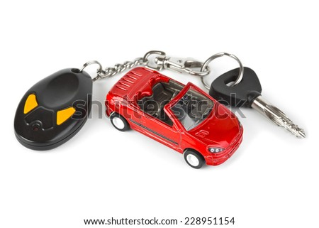 Toy car and keys isolated on white background - stock photo