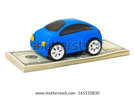 Toy car and money isolated on white background - stock photo