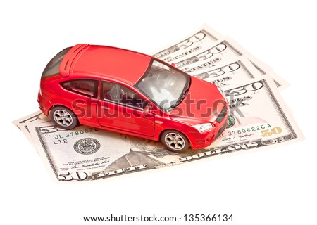Toy car and money over white. Rent, buy or insurance car concept - stock photo