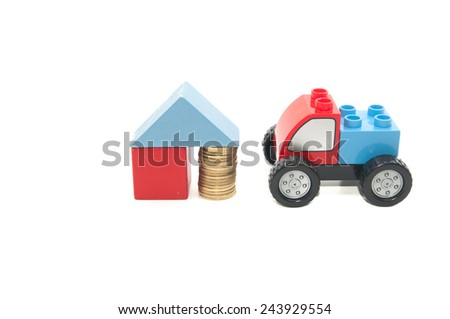 Toy car and stack of gold coins isolated on white background. - stock photo