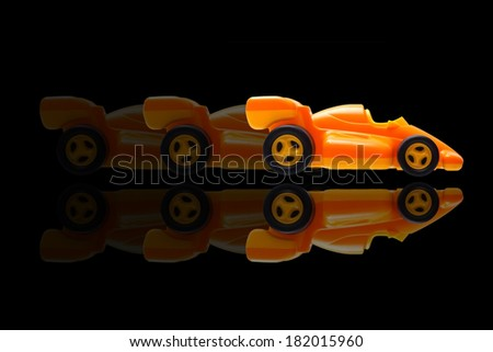Toy car in motion over black background - stock photo