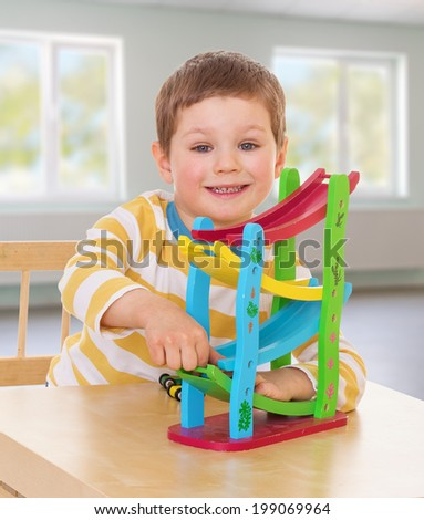 toy car in the hands of the overpass charming little boy. - stock photo