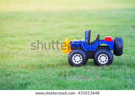 Toy car isolated in field of green grass