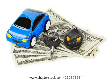 Toy car, keys and money isolated on white background - stock photo