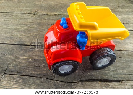 Toy car on a rustic wood background. Childhood concept. - stock photo