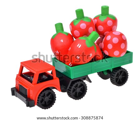 toy car the truck with strawberry wooden toy isolated on white background - stock photo